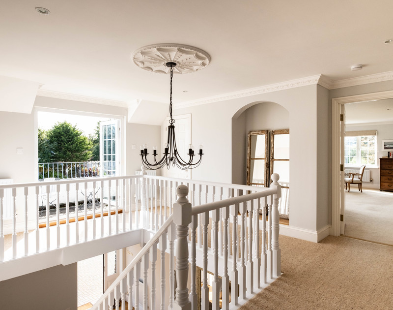 The upstairs landing with a sunny terrace at Carrek House self catering holiday home in Rock, North Cornwall.