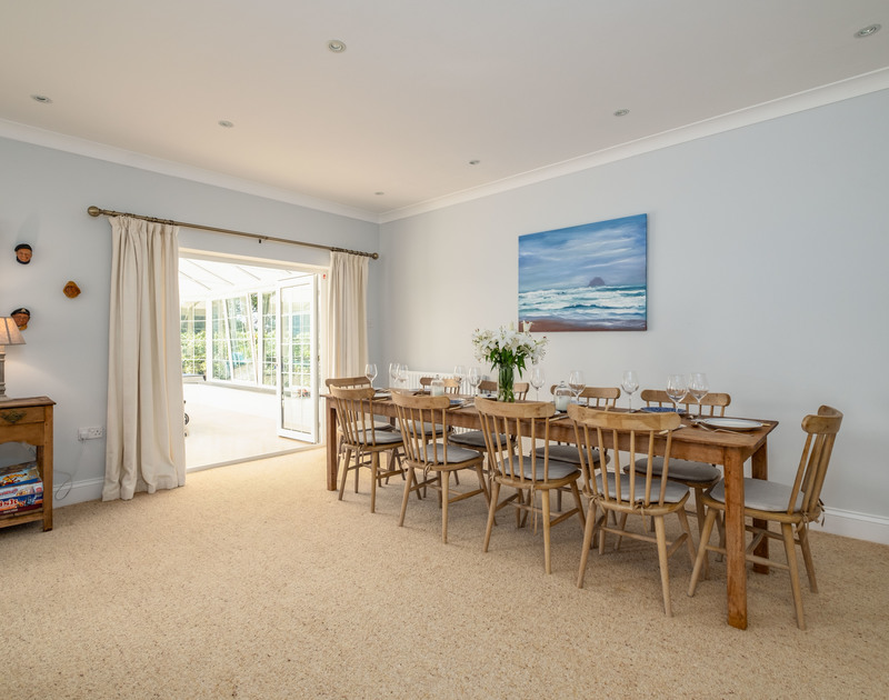 The open plan living and dining room with access to the sunny games room at Carrek House self catering holiday home in Rock, North Cornwall.