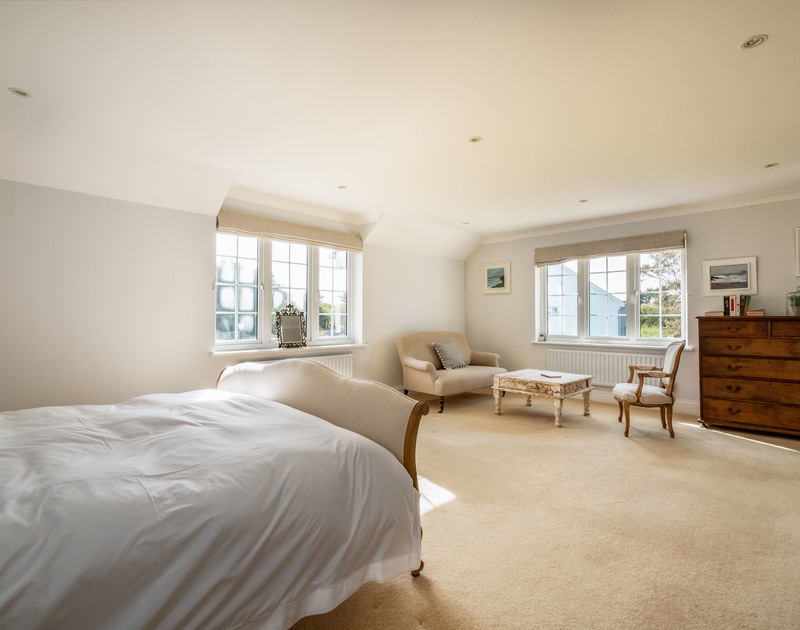 The spacious master bedroom at Carrek House self catering holiday home in Rock, North Cornwall.