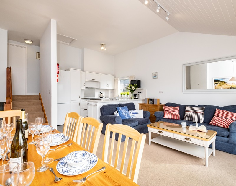The open plan living room, kitchen and dining area at Slipway 7 self catering holiday home in Rock, North Cornwall.
