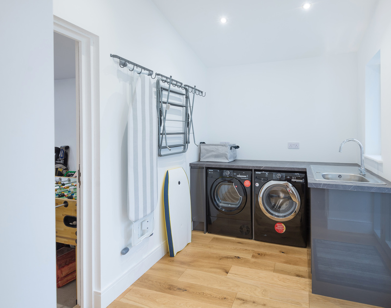 The utility room at Artemis self catering holiday home in Rock, North Cornwall.