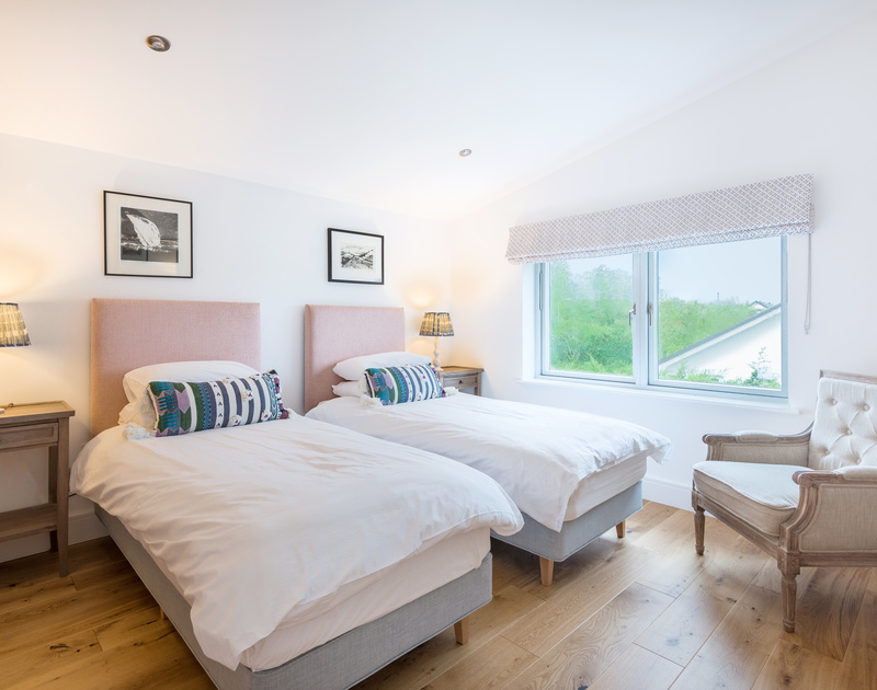The twin bedroom with ensuite bathroom at Artemis self catering holiday home in Rock, North Cornwall.