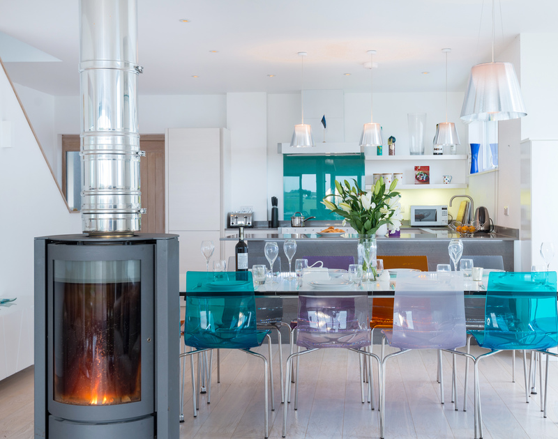 Relax in this sophisticated open plan living area at Stepper Point self catering holiday home in Polzeath, North Cornwall.