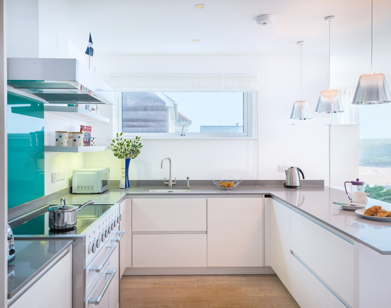 The light filled kitchen at Stepper Point self catering holiday home in Polzeath, North Cornwall.