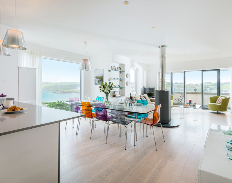 The light filled open plan living space with sea views at Stepper Point self catering holiday home in Polzeath, North Cornwall.