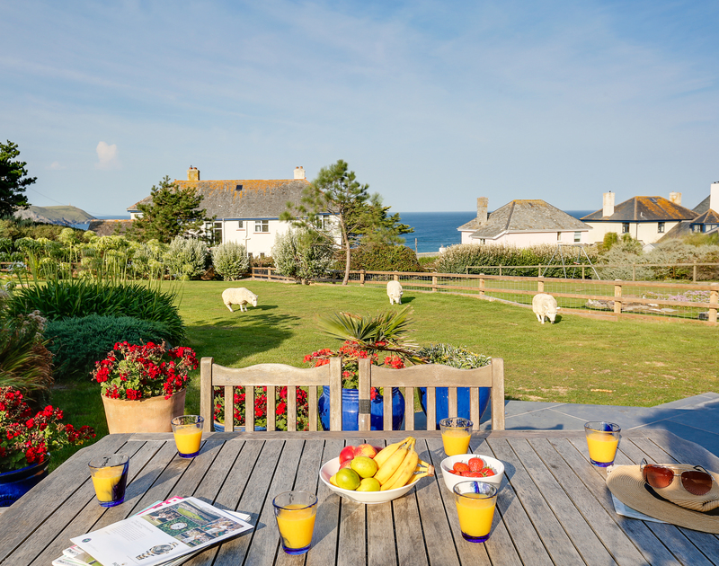 The large garden with sea views at Chy-An-Ros self catering holiday home in New Polzeath, North Cornwall.