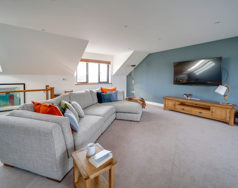 The comfortable living room with TV at Chy-An-Ros self catering holiday home in New Polzeath, North Cornwall.