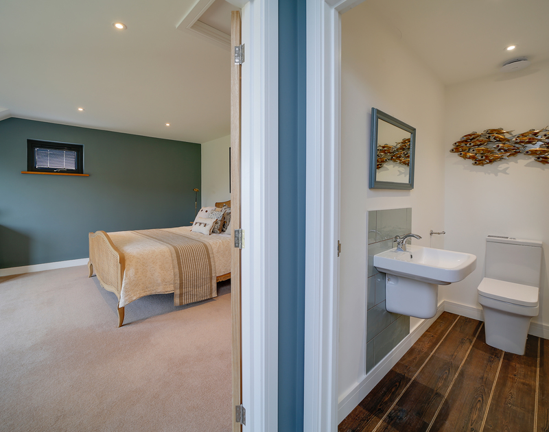 The downstairs bathroom and double bedroom at Chy-An-Ros self catering holiday home in New Polzeath, North Cornwall.