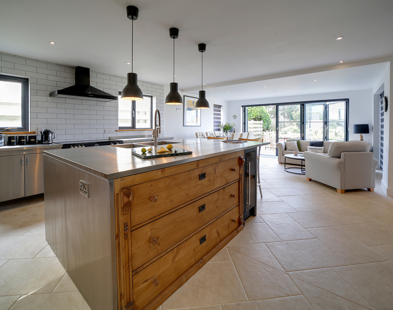 The open plan kitchen, living and dining area at Chy-An-Ros self catering holiday home in New Polzeath, North Cornwall.
