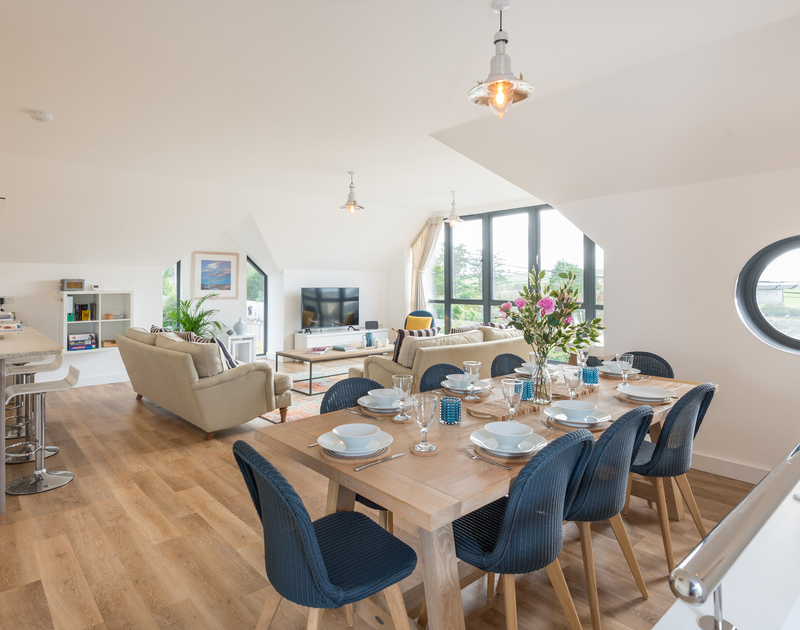 The open plan kitchen, living and dining area at First Light self catering holiday home in Rock, North Cornwall.