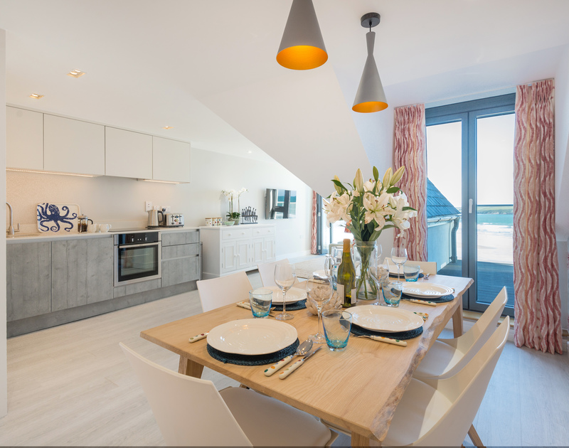 The light filled open plan kitchen, dining and living area at Greenaway self catering holiday home in New Polzeath, North Cornwall.