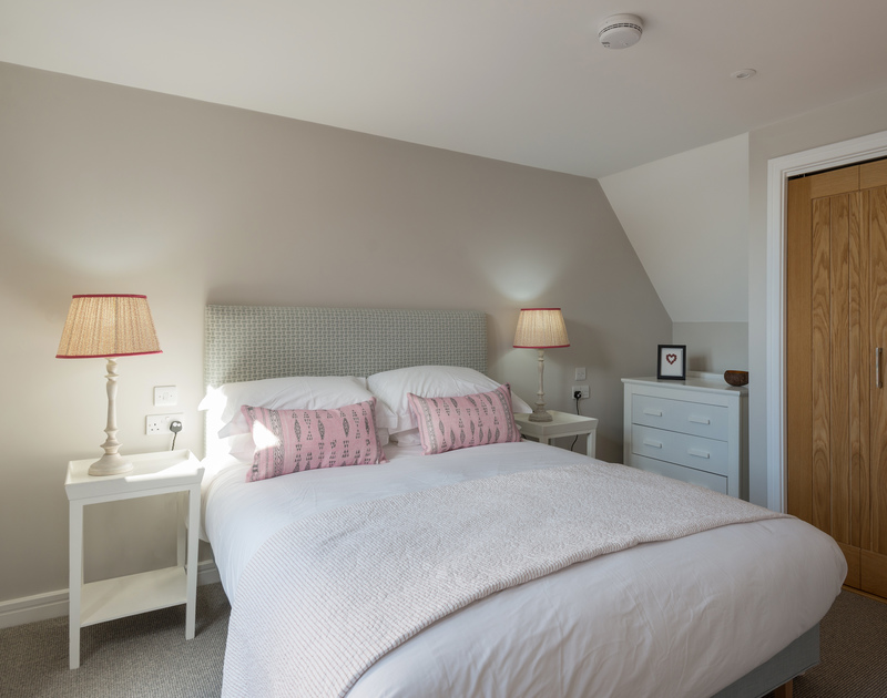 The master bedroom at Greenaway Apartment 8 Atlantic House self catering holiday home in New Polzeath, North Cornwall.