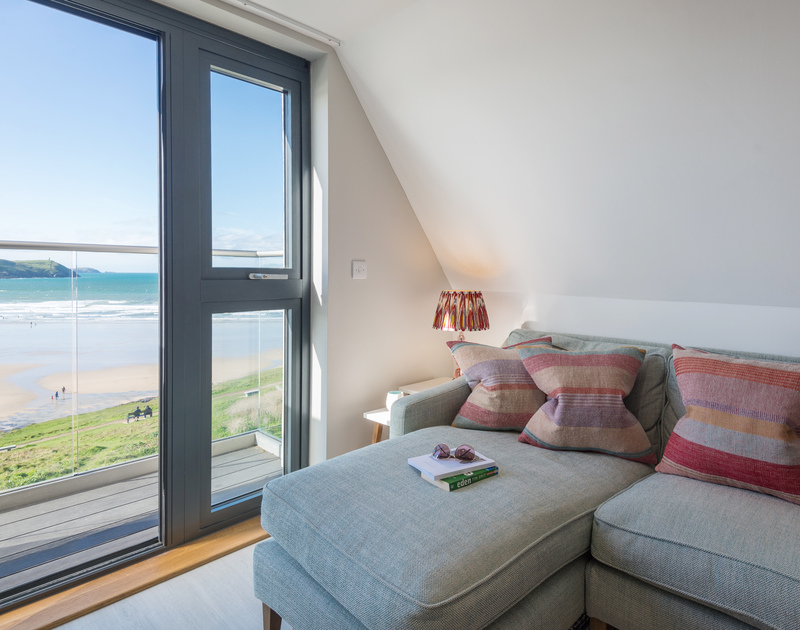 The beautiful views from the balcony at Greenaway Apartment 8 Atlantic House self catering holiday home in New Polzeath, North Cornwall.