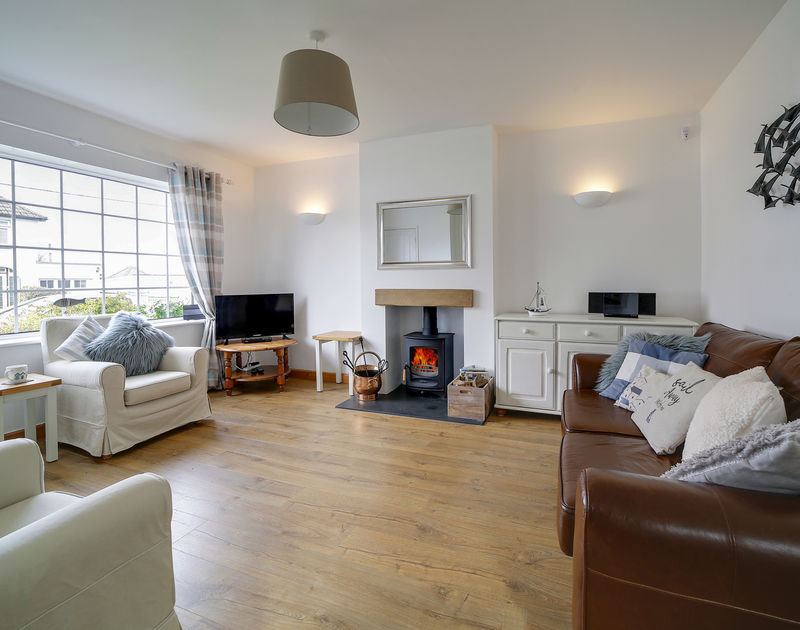 The lounge with coastal interiors at Little Sark self catering holiday home in Port Isaac, North Cornwall.
