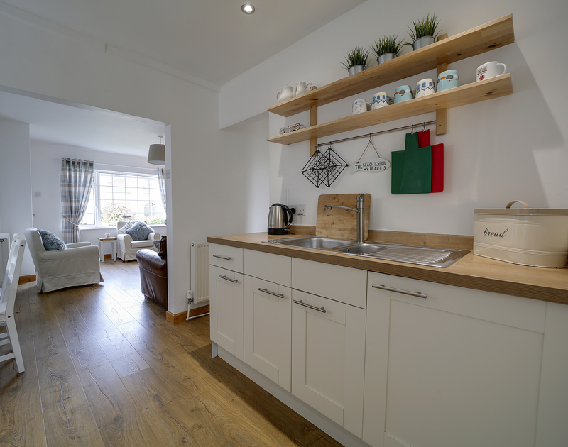 The kitchen with everything you need on holiday at Little Sark self catering holiday home in Port Isaac, North Cornwall.