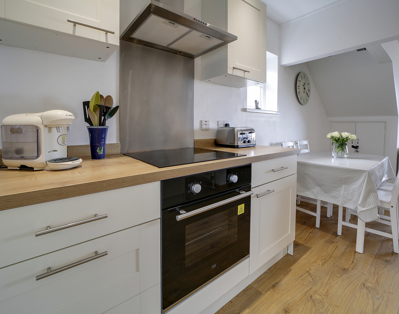 The lovely kitchen and dining room at Little Sark self catering holiday home in Port Isaac, North Cornwall.