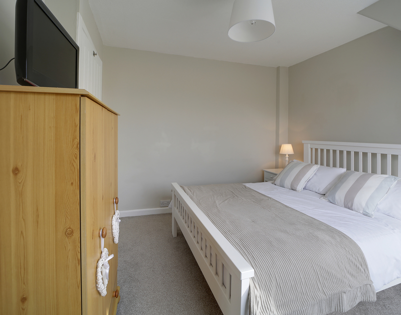 The master bedroom at Little Sark self catering holiday home in Port Isaac, North Cornwall.