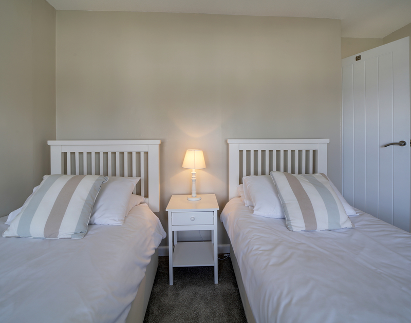 The twin bedroom at Little Sark self catering holiday home in Port Isaac, North Cornwall.