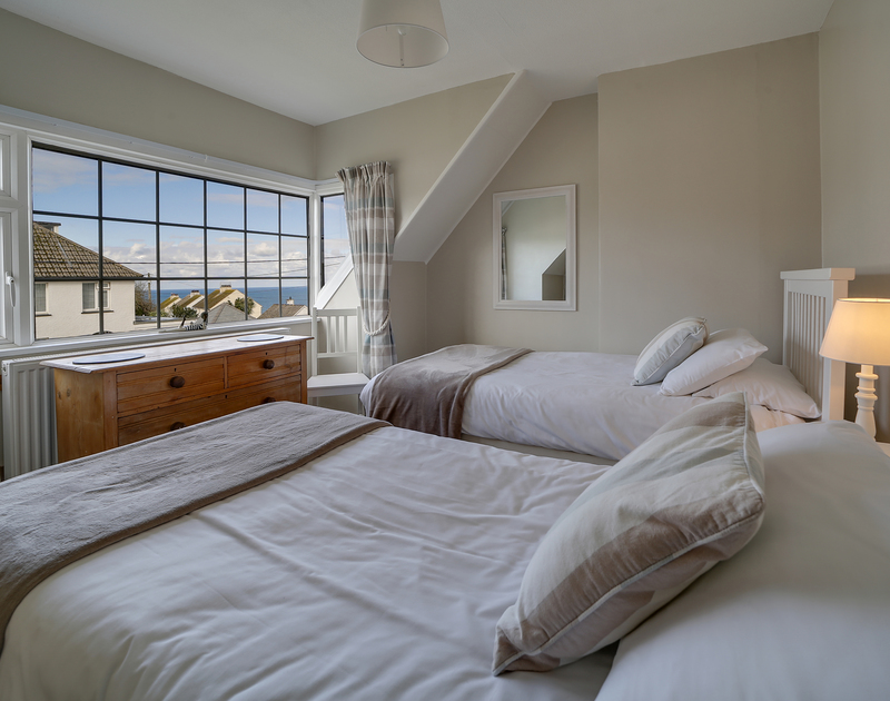The twin bedroom with sea views at Little Sark self catering holiday home in Port Isaac, North Cornwall.