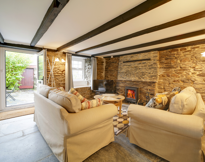 The cosy lounge with wood burner at Dane Cottage self catering holiday home in Port Isaac, North Cornwall.