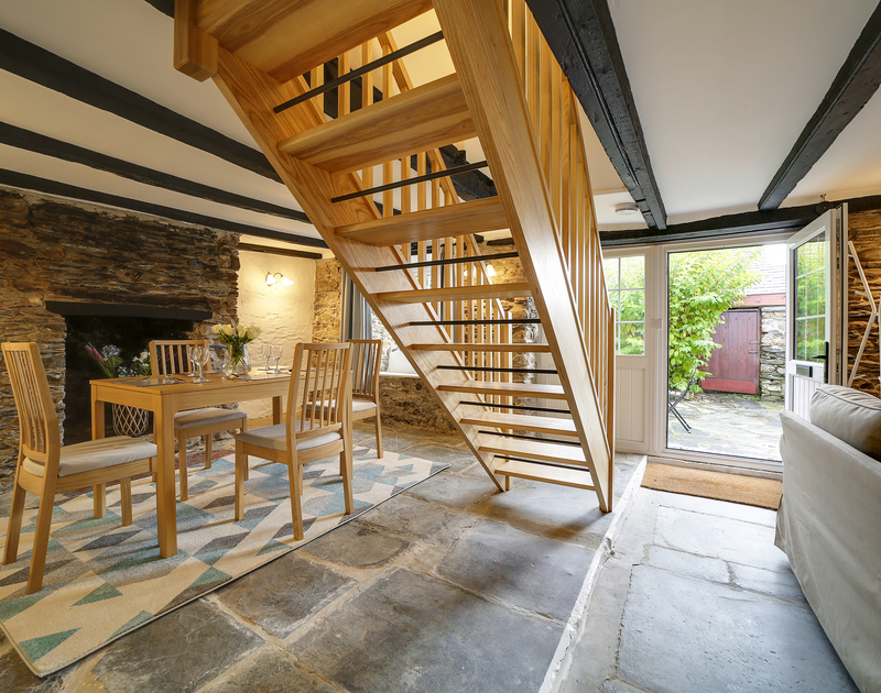 The slate floored open plan living space at Dane Cottage self catering holiday home in Port Isaac, North Cornwall.