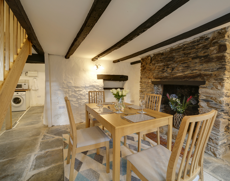 The dining area at Dane Cottage self catering holiday home in Port Isaac, North Cornwall.