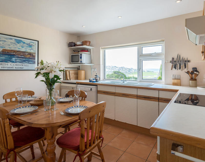 The well-equipped kitchen at Bella Vista self catering holiday home in Polzeath, North Cornwall.