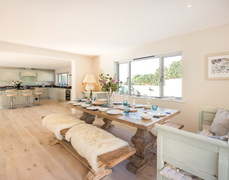 The elegant dining area at Greenaway Heights self catering holiday home in Daymer Bay, North Cornwall.