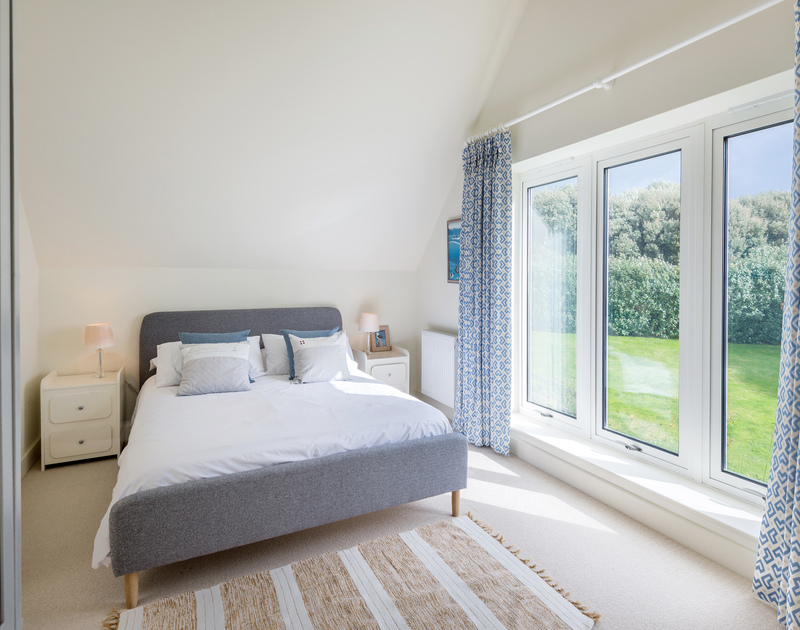 The double bedroom with ensuite bathroom at Greenaway Heights self catering holiday home in Daymer Bay, North Cornwall.
