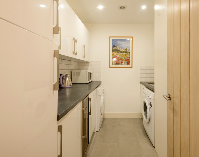 The useful utility room at Stepper Point self catering holiday home in Polzeath, North Cornwall.