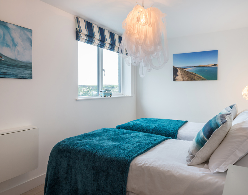One of the twin bedrooms with sea views at Stepper Point self catering holiday home in Polzeath, North Cornwall.