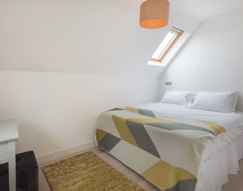 The king bedroom with en suite bathroom at Stepper Point self catering holiday home in Polzeath, North Cornwall.
