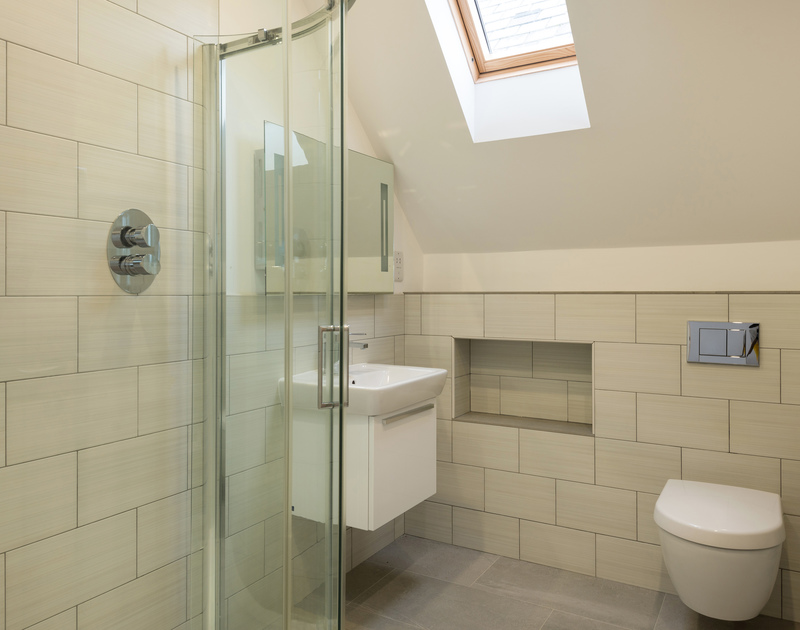 The king bedroom en suite at Stepper Point self catering holiday home in Polzeath, North Cornwall.