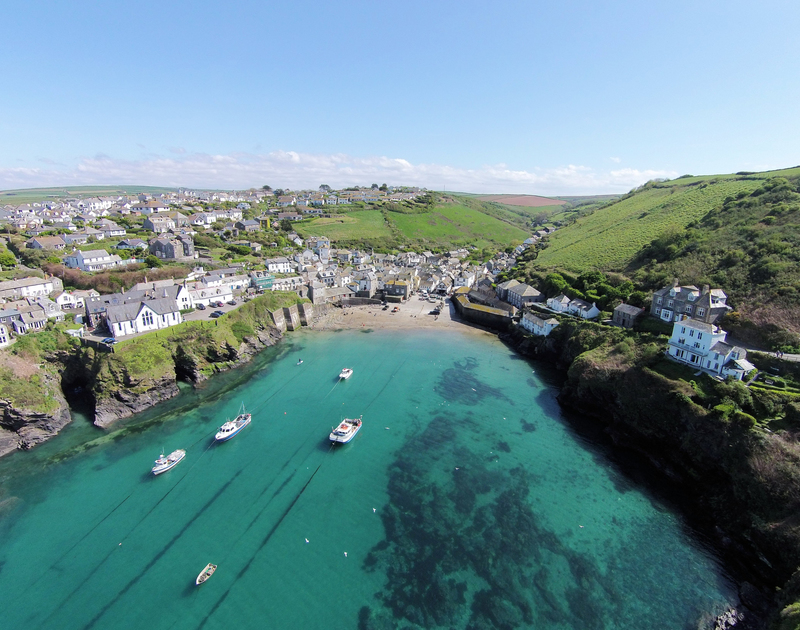 An aerial view of Port Isaac harbour and village a short walk from Dane Cottage in Port Isaac, North Cornwall.