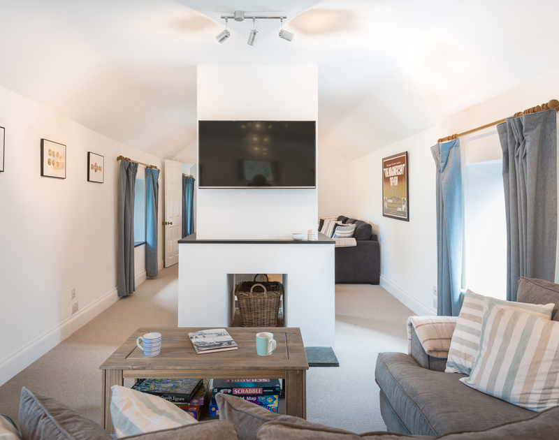 The comfortable living room at Orchard Cottage self catering holiday home in Trelights, Port Isaac, North Cornwall.