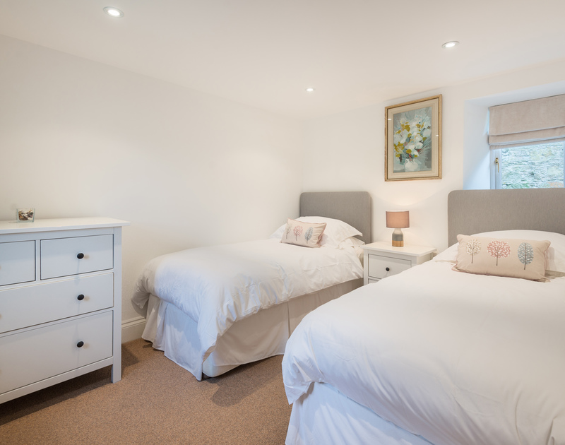 The twin bedroom at Orchard Cottage self catering holiday home in Trelights, Port Isaac, North Cornwall.