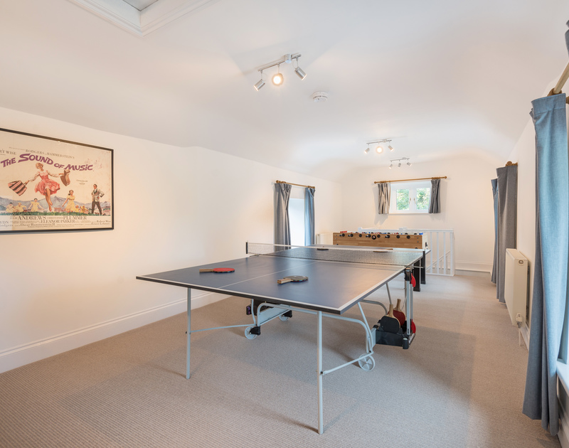 The games area with table tennis and table football at Orchard Cottage self catering holiday home in Trelights, Port Isaac, North Cornwall.