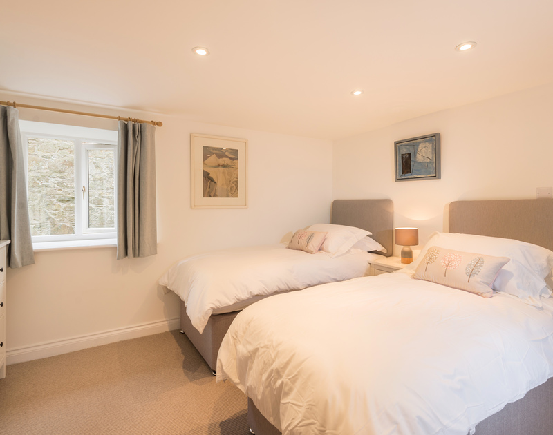 The second twin bedroom at Orchard Cottage self catering holiday home in Trelights, Port Isaac, North Cornwall.