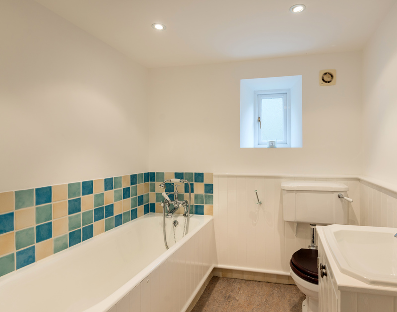 The family bathroom at Orchard Cottage self catering holiday home in Trelights, Port Isaac, North Cornwall.
