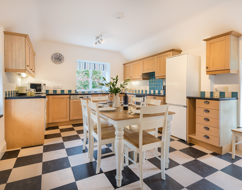 The well-equipped kitchen and lovely dining area at Orchard Cottage self catering holiday home in Trelights, Port Isaac, North Cornwall.