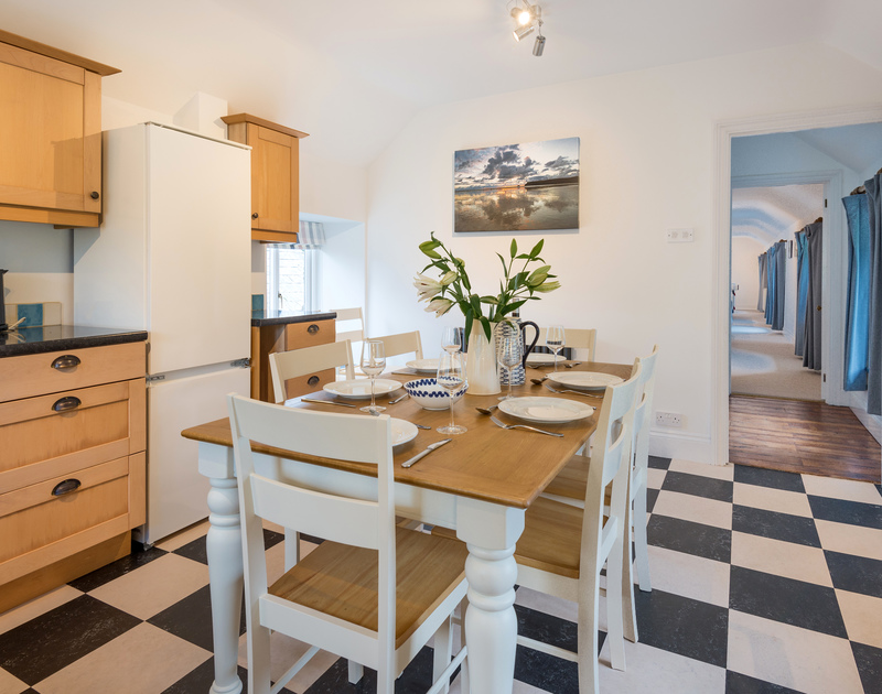 The dining area at Orchard Cottage self catering holiday home in Trelights, Port Isaac, North Cornwall.