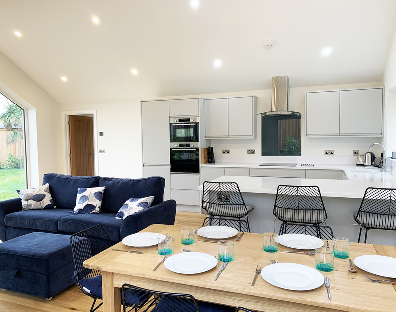 The light filled kitchen, living and dining room at Barcelona self catering holiday home in Rock, North Cornwall.