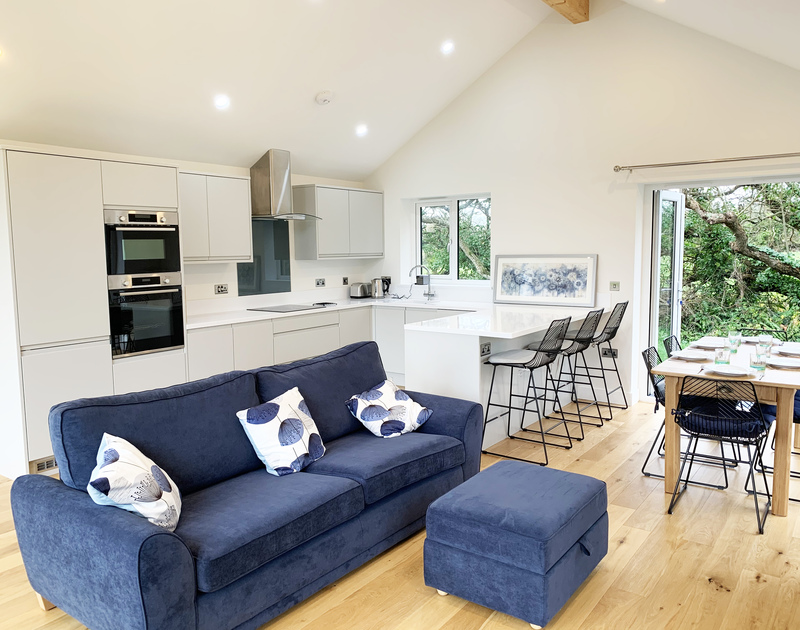 The open plan kitchen, dining and living area in Barcelona self catering holiday home in Rock, North Cornwall.