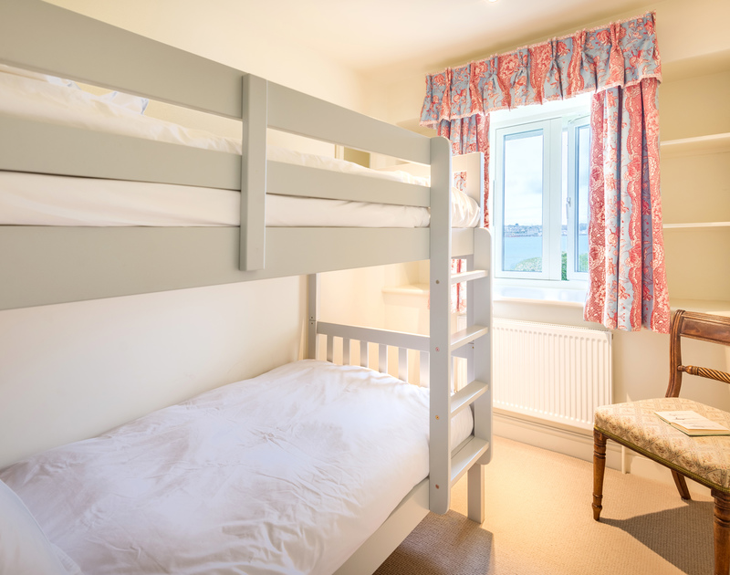 The bunk bedroom with estuary views at Harbour Lights self catering holiday home in Rock, North Cornwall.