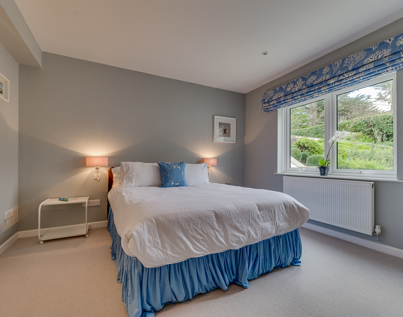 The downstairs bedroom with garden views at Landers Field self catering holiday home in Rock, North Cornwall.