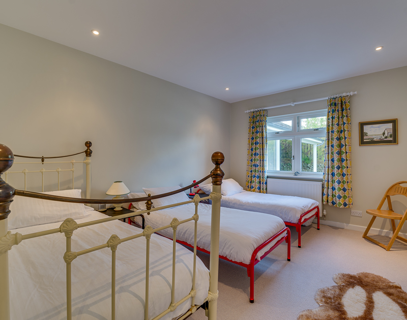 The triple twin bed room at Landers Field self catering holiday home in Rock, North Cornwall.