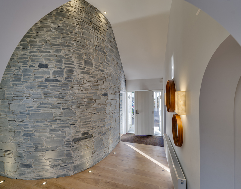 The exposed stone wall feature in Landers Field self catering holiday home in Rock, North Cornwall.