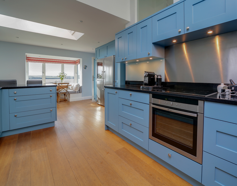 The kitchen with Estuary views at Camel Point self catering holiday home in Rock, North Cornwall.