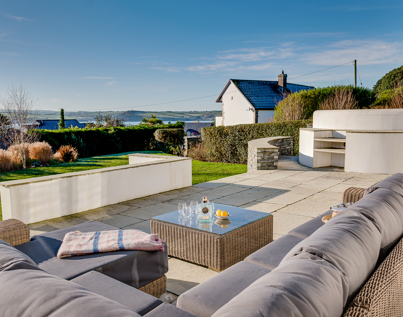 The comfortable outdoor sofa for relaxing on the terrace at Landers Field self catering holiday home in Rock, North Cornwall.