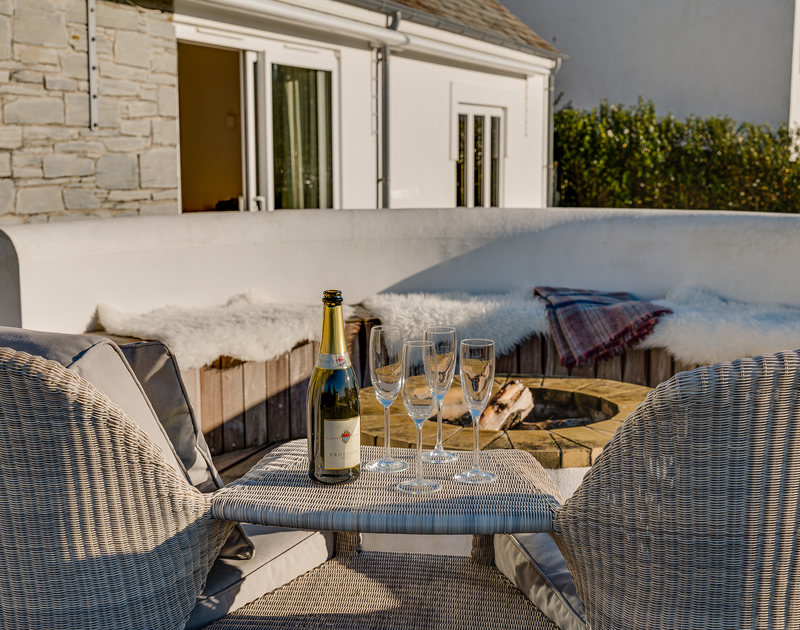 Enjoy a glass of bubbles with you relax at Landers Field self catering holiday home in Rock, North Cornwall.